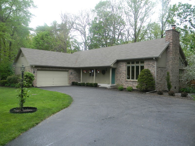 Stunning ranch with walk-out basement on wooded 1.3 acre lot!