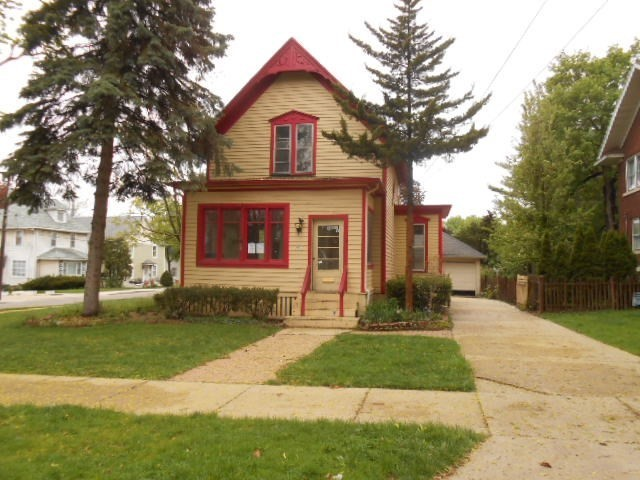 Charming home in established area with enclosed front porch.